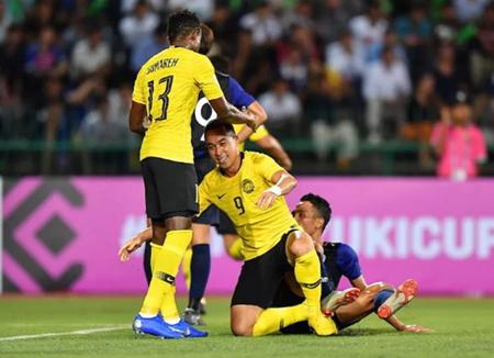 Niềm vui của các cầu thủ Malaysia sau bàn mở tỷ số của Talaha.