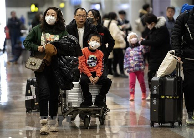 Hành khách đeo khẩu trang để phòng tránh sự lây lan của virus corona tại sân bay Bắc Kinh, Trung Quốc, ngày 21/1/2020.