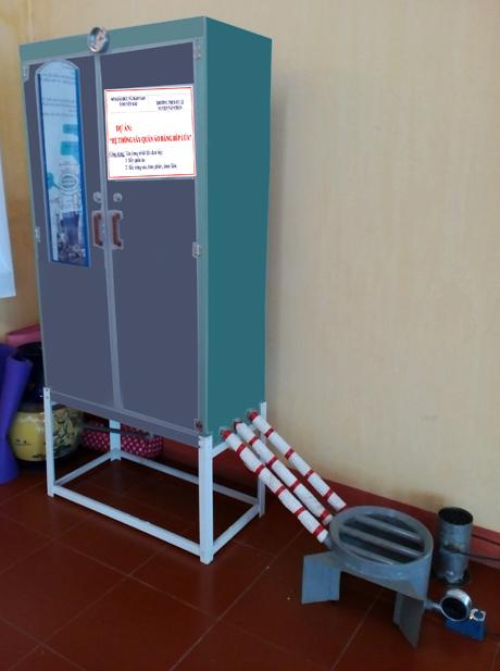 Hệ thống sấy quần áo bằng bếp lửa của 2 học sinh Lò Văn Chung và Lý Văn Tuấn - Trường THCS Tú Lệ (Văn Chấn).