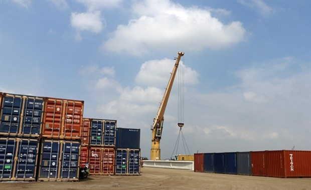 Cargo containers are loaded at My Thoi Port in the southern province of An Giang.
