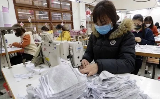 Workers produce garment products for export.